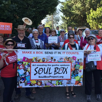 Soul Box banner held by people marching