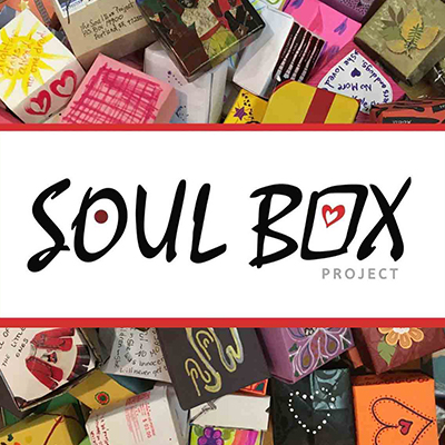Soul Box Logo with Boxes in the Background