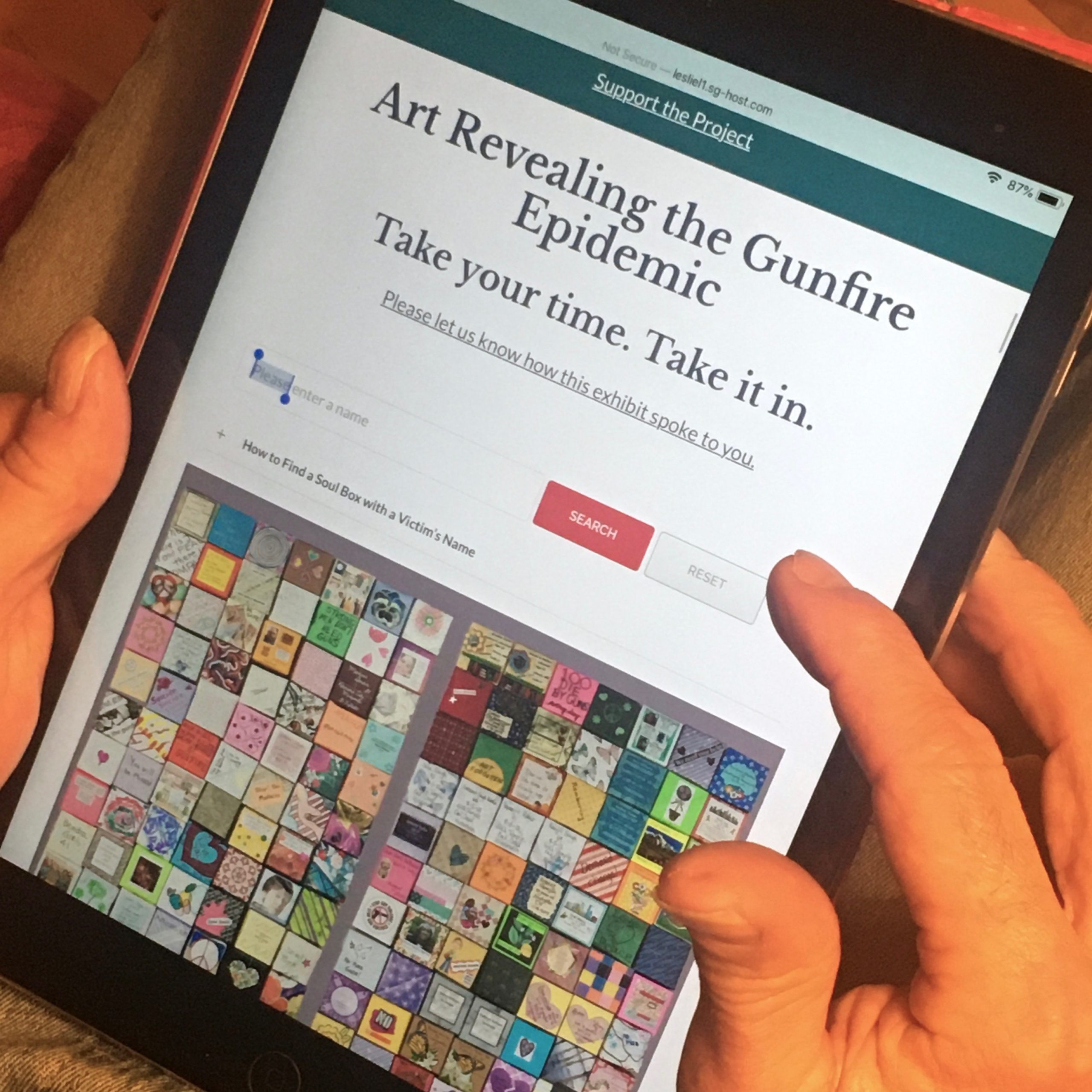 Tablet displays online exhibit search page