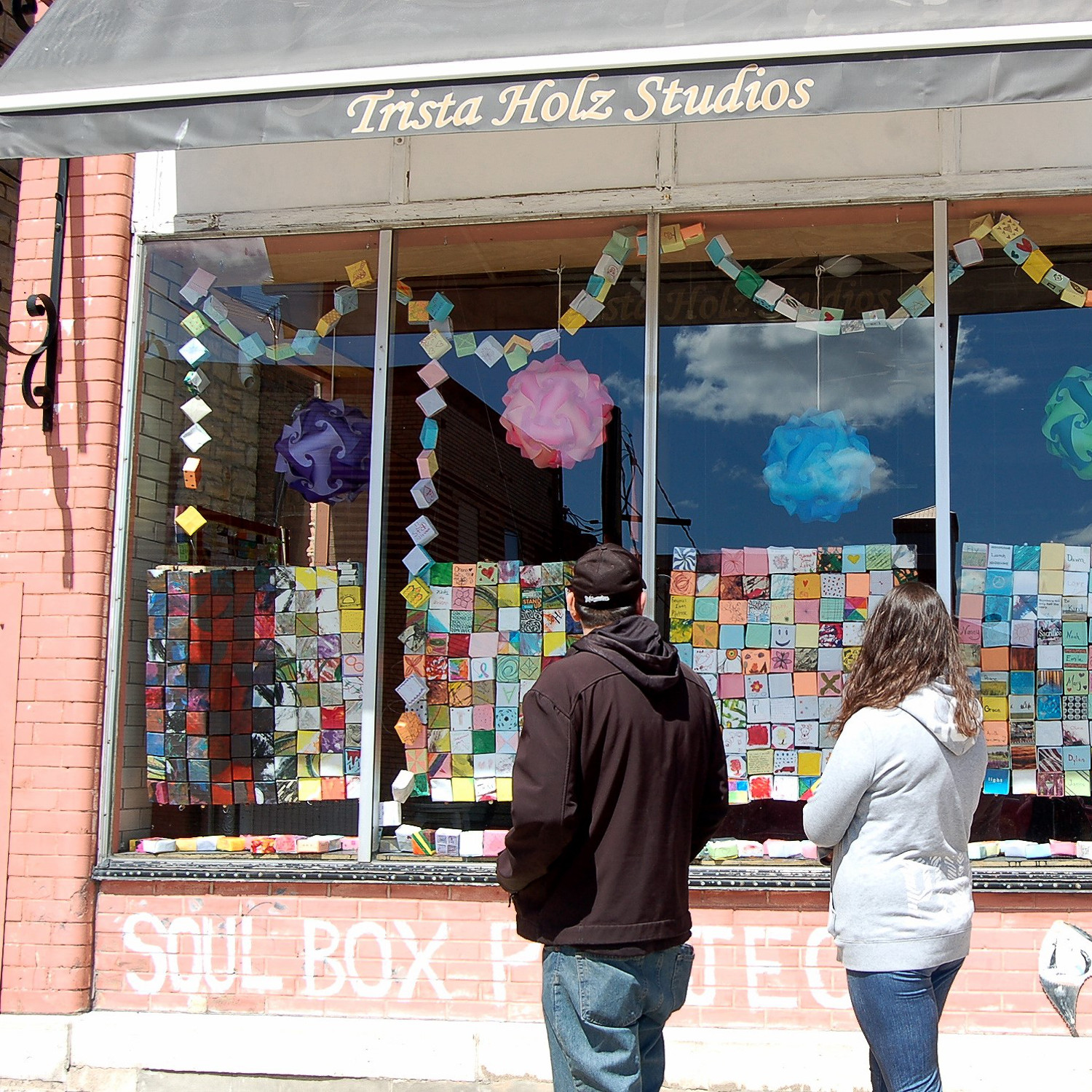 Shop window exhibit, Trista Holtz Studios, Fond Du Lac, WI. Boxes made by Art Therapy and Art students and athletes at Marian University, Oshkosh, WI