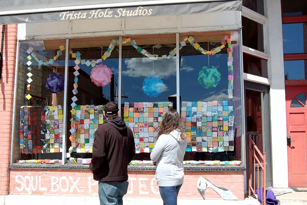 Exhibit in shopfront window, Trista Holz Studios, Fond du Lac, WI. Soul Boxes made by Marian University athletes and students of art and art therapy