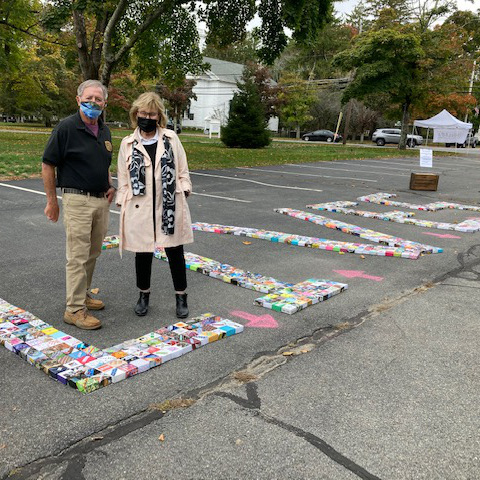 """Boxes spelling """"LIVES"""" on pavement were made by South Shore Moms Demand Action, Grandmothers Against Gun Violence, and members of the First Parish Church, Kingston, MA"""