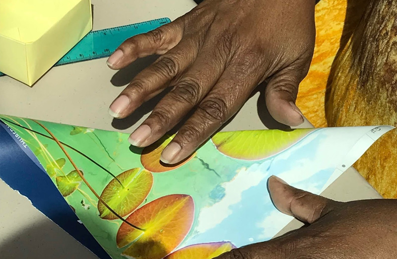 Woman's hands showing how to fold a soul box
