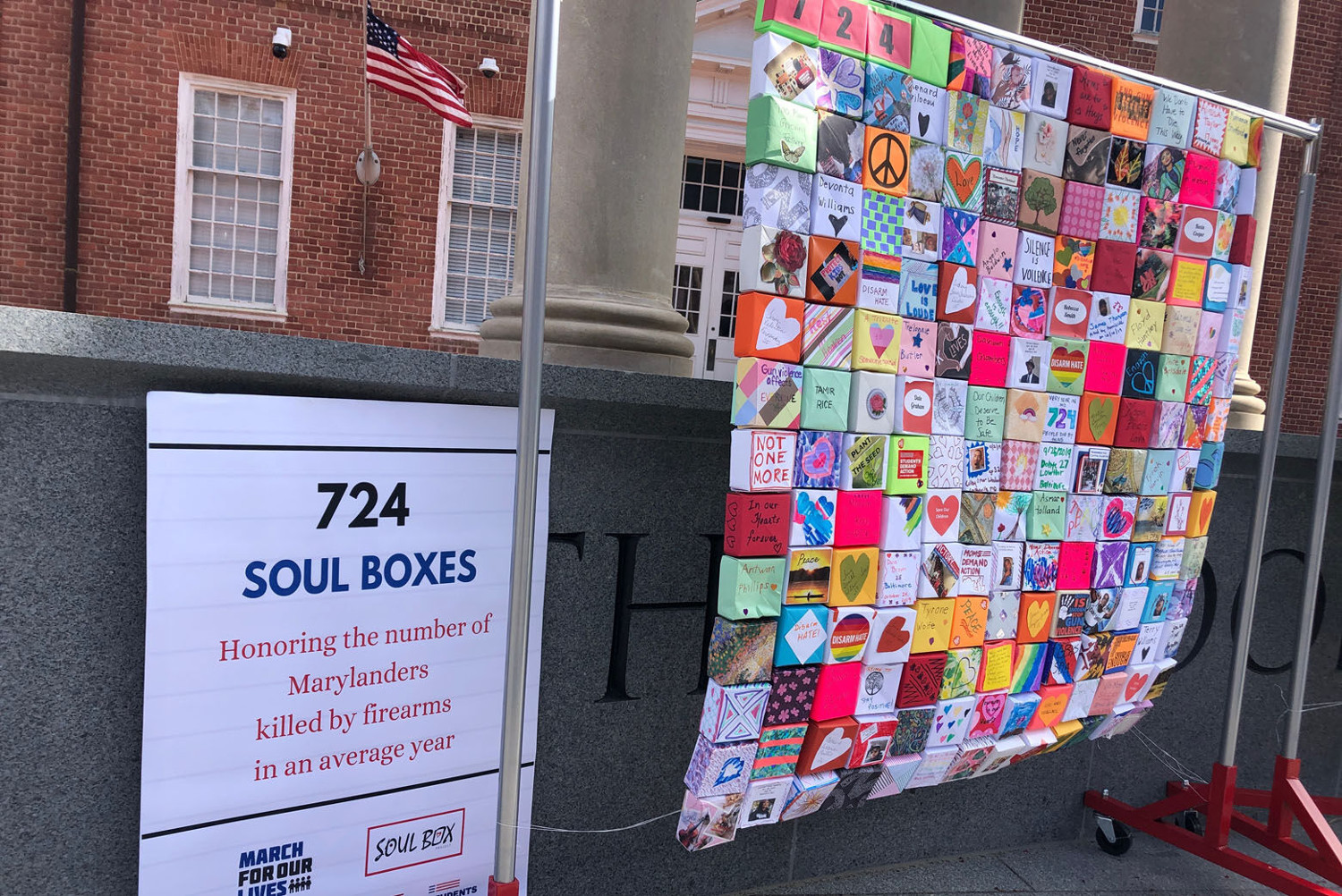 """A panel of Soul Boxes and sign, """"724 Soul Boxes,"""" displayed outside the Maryland State House"""