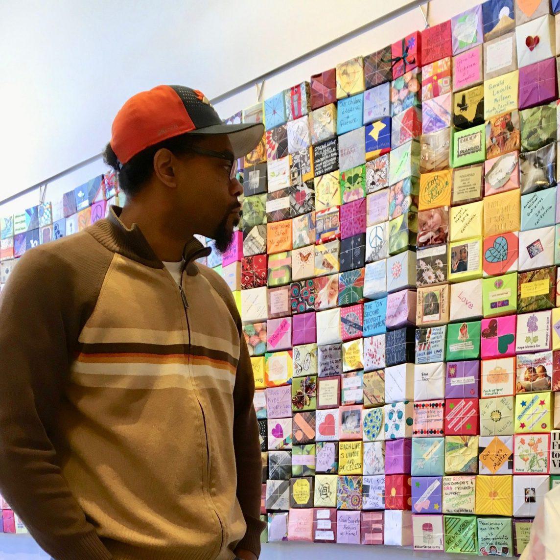 Man views Soul Box exhibit, Portland, OR
