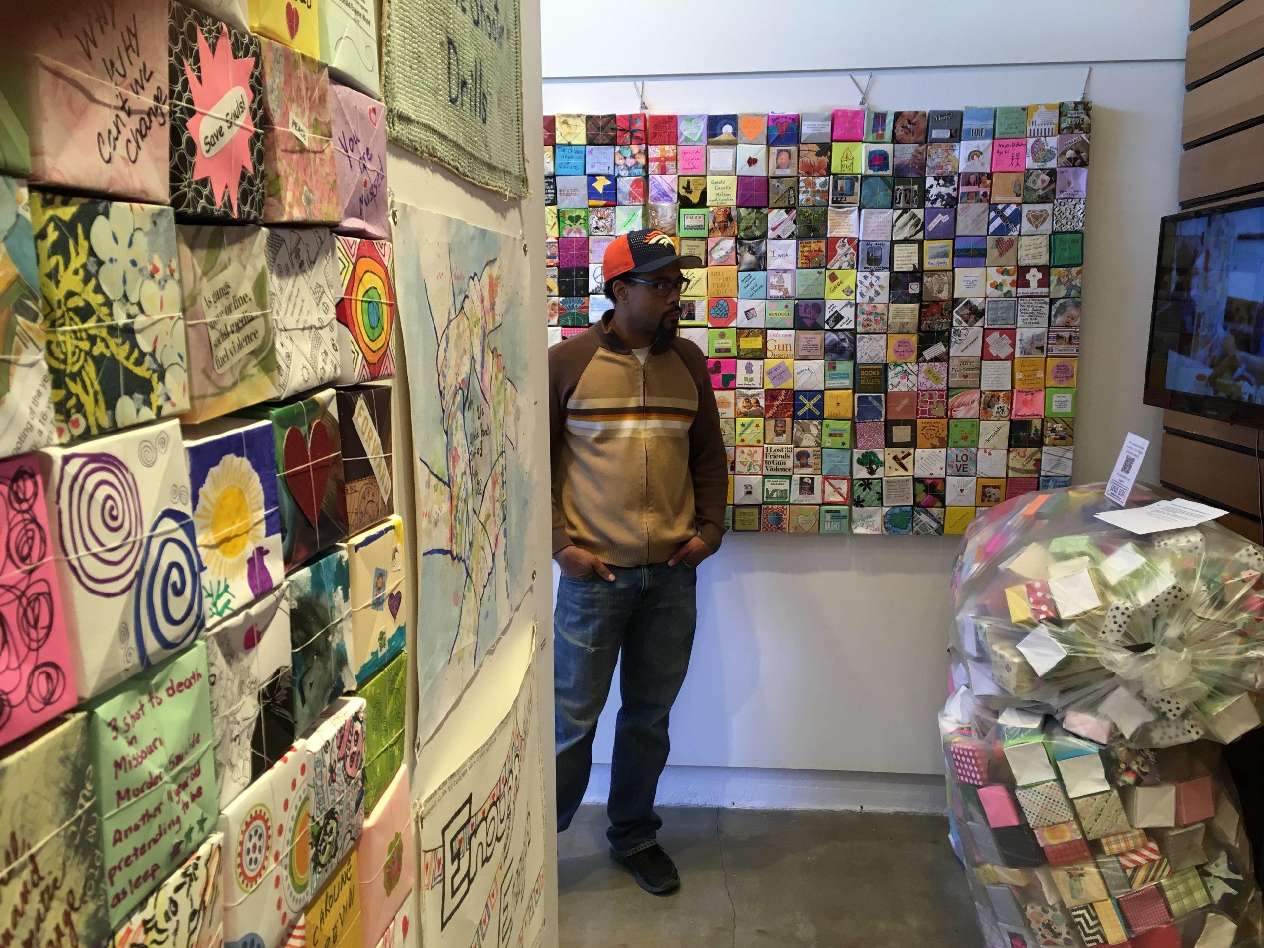Man looking through hallway of Soul Box Exhibits