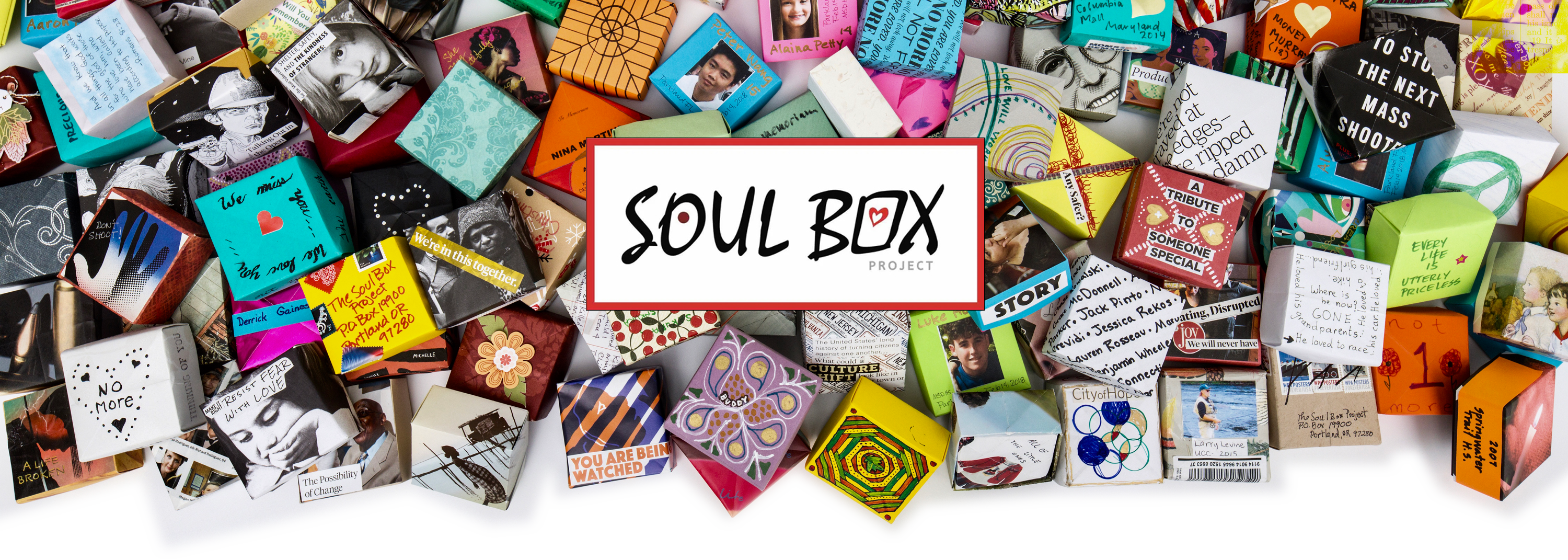 Homepage header image of origami folded boxes falling down with Soul Box Logo in the middle