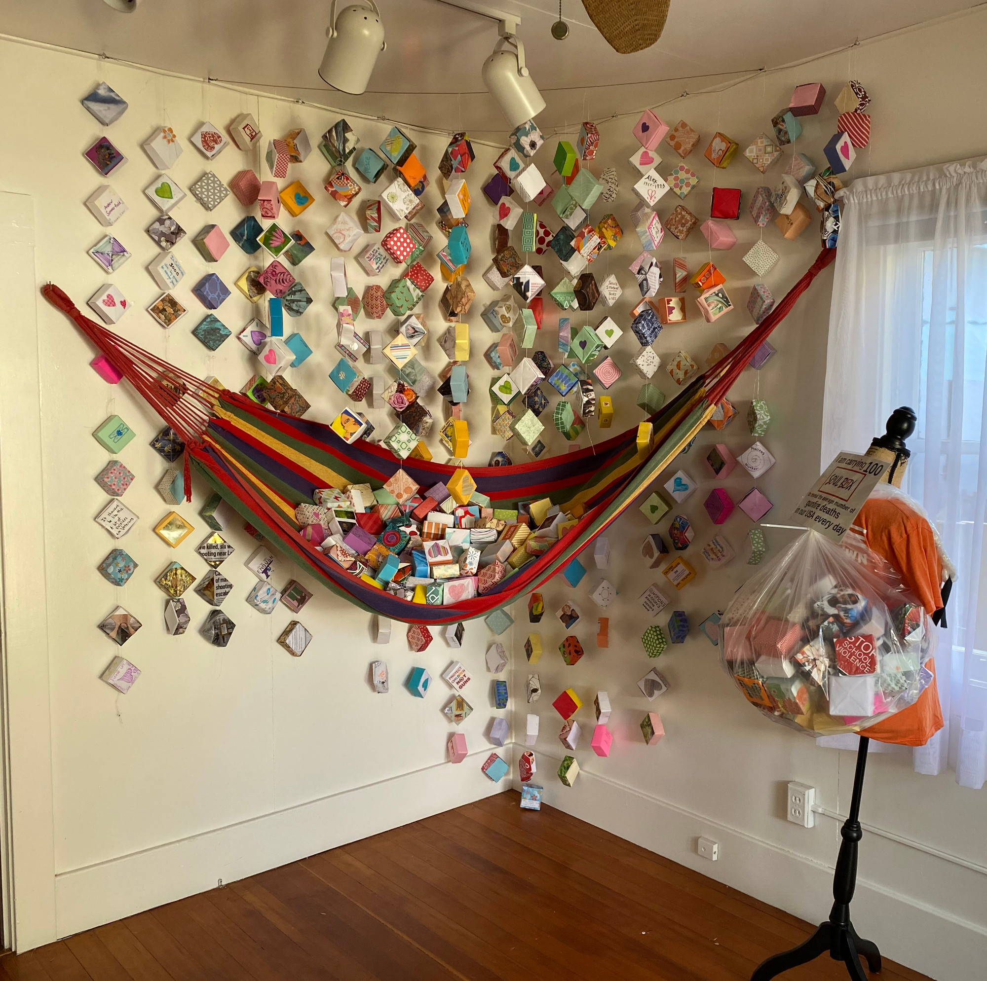 Strands on the wall and piles of Soul Boxes in a hammock