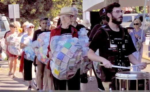procession led by a solemn drum cadence is an emotional memorial to victims of gunfire violence